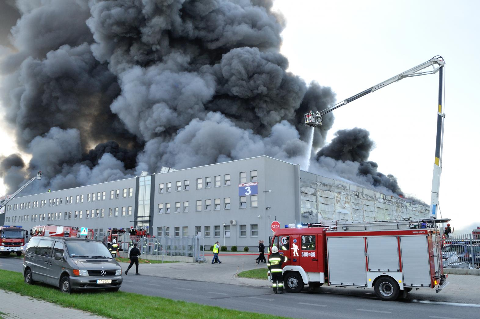 Firefighting crews battle a storehouse fire in Europe